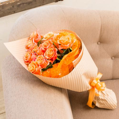 気がでるオレンジのバラの花束